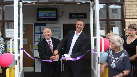 Cllr Alan Melton, left, and Cllr Martin Curtis cut a ribbon to launch the new community hub.
