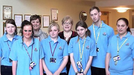 College of West Anglia Isle campus students helped out at Glenfield care home.