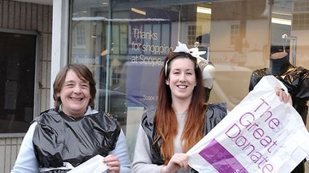 Louise Bryan, right, outside the Scope charity shop last year with volunteer Yvonne Hancox. Staff an