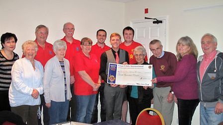 Members of March Lions Club donate their cheque to Leigh Broughton, centre, of Sue Ryder Care.