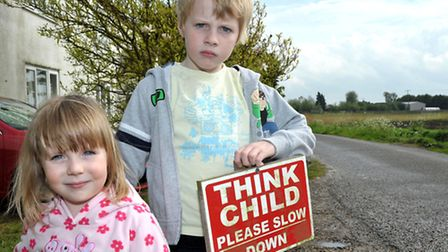 Speeding in Euximoor Drove, Christchurch. Lily-Rose her brother Jacob Crout. Picture: Steve Williams