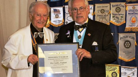 District governor Bill Redmayne presenting the framed plaque to president Eric Grant