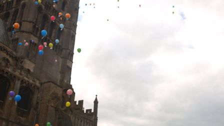 Balloons are released outside Ely Cathedral
