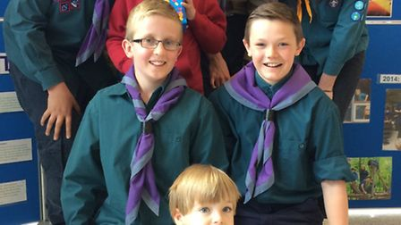 Ely District Scouts pictured with Easter egg hunt winners Harry Sutton, 3, and Mitchell Wells, 6.