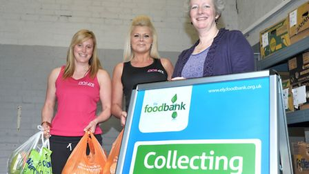Donation to March food bank by Finesse Training. Left: Hannah Dawson personal trainer, Prue Day and