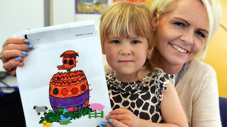 Colouring competition winner, Mia (4) with Harrison Murray March branch sales manager, Nicola Robert