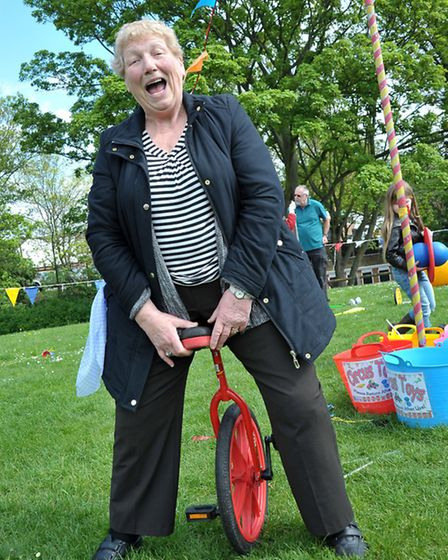 St George's Fayre, March. Margeret Leak has a go on a unicycle.Picture: Steve Williams.