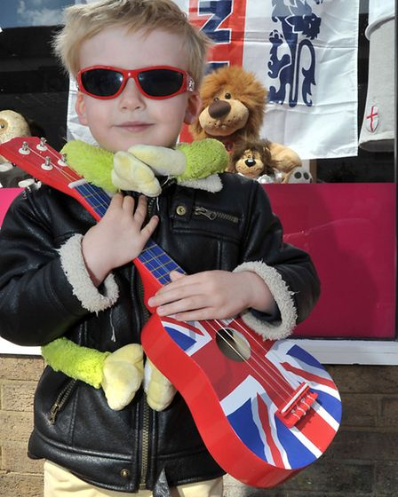 St George's Fayre, March. Oliver Nichol age4 with his guitar. Picture: Steve Williams.