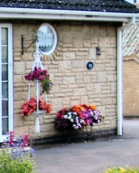 Margaret Fox had hanging baskets made by late friend stolen from front porch. One of the hanging bas