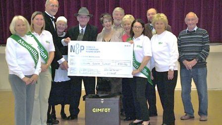 Simon Keymer, chairman of Blasts from the Past, presents the cheque to Gill Smith, chairman of March