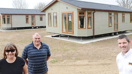 Lode Hall caravan park has some new lodges. Pictured are (from left) Fran and Dick Johnson with Rich