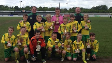 Dunmow Rhodes Lions U11, back row from left, Sam Purcell, coach Mark Williamson, Alfie Bowen, Dylan