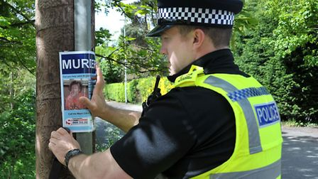Una Crown Press conference.Wisbech. PC Daniel Gardner fixing one of the new posters. Picture: Steve