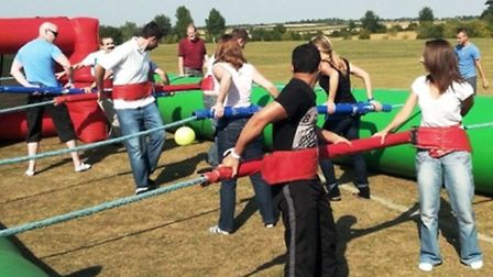 Participants will be strapped in to a life-size table football arena