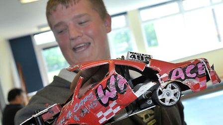 March RC Raceway, Aston Gibbons with his badly damaged banger car after the race. Picture: Steve Wil