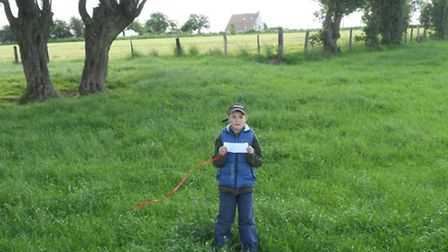 Laurent with the note at the spot where the balloon was found