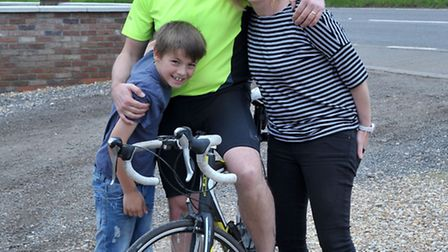 Cyclist stopped of in Guyhirn as part of epic John O'Groats- Ipswich cycle. Left: Dan, Paul and Lucy