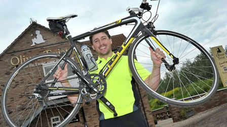 Cyclist stopped of in Guyhirn as part of epic John O'Groats- Ipswich cycle. Paul Bryanton at the Ol