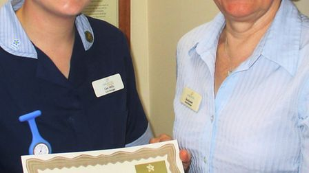 General manager Susan Scarlett presenting Ceri Mills (left) with her certificate to let her know she