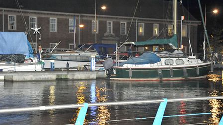 North End Wisbech, View of river in flood and boats at eye view with police station.