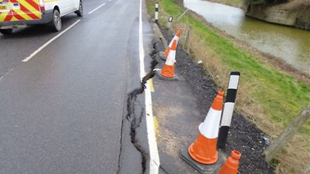 Road cracking at level crossing