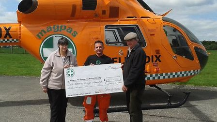 Linda and Trevor Brown hand over a cheque to Simon Standen, from Magpas.