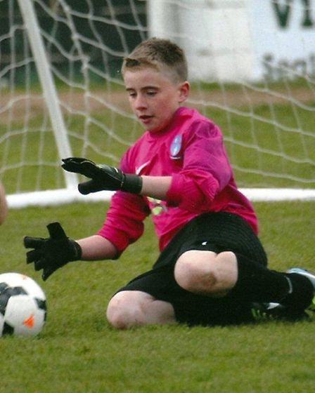 James Mitchell makes a late save in Flitch Youth Blues U12's cup reply against Baddow Spartak.