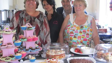MP Steve Barclay, Cllr Sam Clark, Brenda Barber and Nicki Rimner with a selection of cakes.