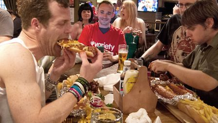 Matt Dibble, left, and Paul Fellows take part in the first heat of the Man vs Food competition. Pict