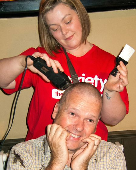 Griffin manager Lee Oldale has his head shaved. Picture: BRIAN PURDY