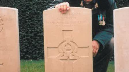 Ken Mayor at his grandfather''s grave in France.