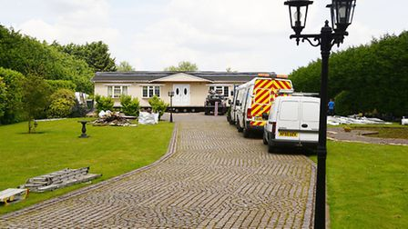 Enforcement officers dismantling Barielly Lodge in Walsoken. Picture: Ian Burt