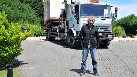 Rodney Wilson in front of the final piece of his home that was taken away following a long running p