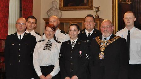 Fenland police officers received District Commander Commendations from the Mayor of Wisbech for thei