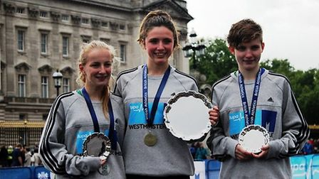 Hollie Parker, centre, collecting her trophy.