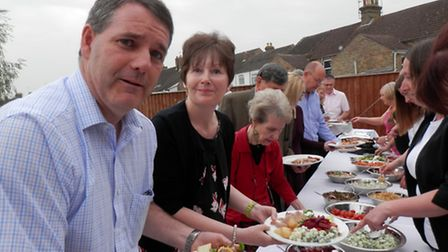 Guests queue up for the hog roast.