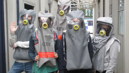 Students dressed for the part to survive in a smoke-filled aircraft.