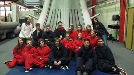 Students and staff pose at the bottom of the escape chute in the training plane at BA's Cranebank ce