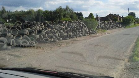 Outwell tyre mountain. Picture: GARY HUNNS