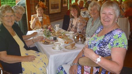 Guests enjoy the tea party.