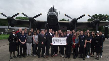 Lee Mallott, front left, uniformed services programme manager, presents the cheque to the regional d