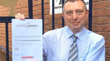 Kevin Smith with his Certificate of Commendation.