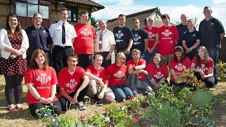 Fire Authority Chairman Sir Peter Brown unveils the garden with The Prince's Trust Team in Fenland a