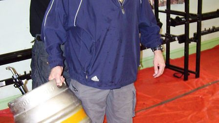 Rotarian Bruce Golson, chair of the organising committee, prepares for the beer festival