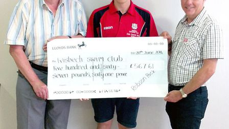 Robson Pack presents a cheque to Wisbech Swimming Club. Left: treasurer John Frusher, Robson Pack an
