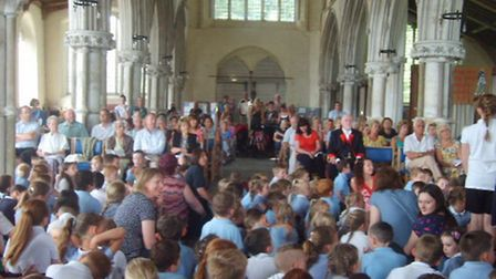 A packed church service.