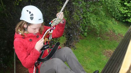 A Brownie tries her hand at abseiling.