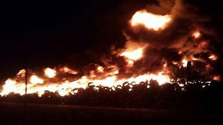 The fire at Outwell, which started after a pile of tyres were set alight. Photo: Georgia Woollard