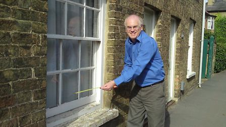 Peter Bates carrying out an energy assessment