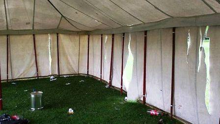 The damaged marquee - which was slashed by yobs